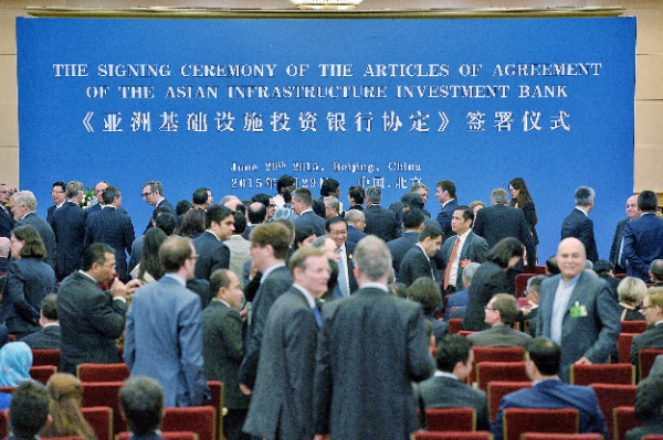 Representatives of prospective founders of the Asian Infrastructure Investment Bank (AIIB) prepare to attend the signing ceremony of the articles of agreement of AIIB in Beijing, capital of China, June 29, 2015 [Xinhua]